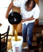 pouring homemade beer into bucket