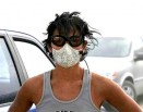 women wearing dust mask after explosion