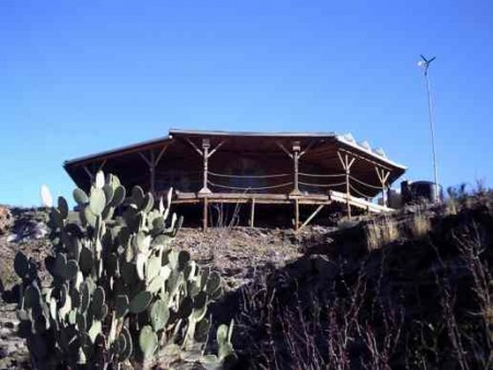 prickly pear cactus and cliff home